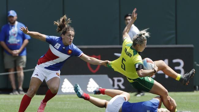 Australia's Emma Tonegato is tackled by France's Marjorie Mayans.