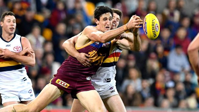 McInerney attempts to mark against the Crows. Picture: Getty Images