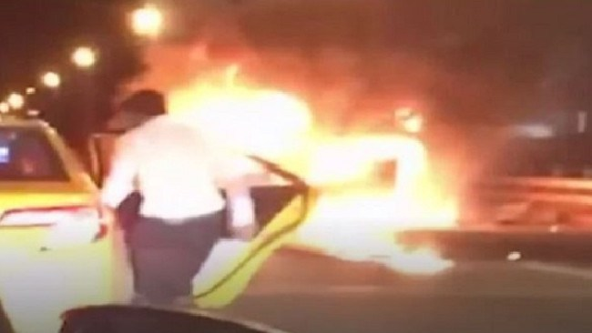 Saeed Ahmad is seen getting into a taxi while his friend burns to death. Picture: Supplied