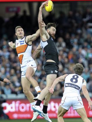 Charlie Dixon rucks against Giant Adam Tomlinson. Picture Sarah Reed