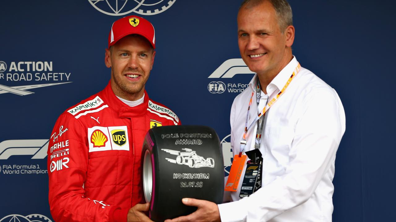 Ferrari's Sebastian Vettel is presented with the Pirelli Pole Position trophy during qualifying for the German Grand Prix on Saturday.