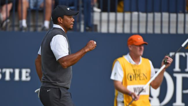Tiger Woods reacts after holing his putt on the 18th. Picture: AFP