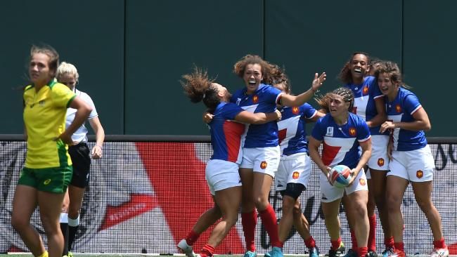 French players celebrate after defeating Australia 19-12 in San Francisco.