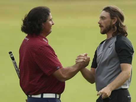 Pat Perez of the US left and Tommy Fleetwood of England shake hands after the third round