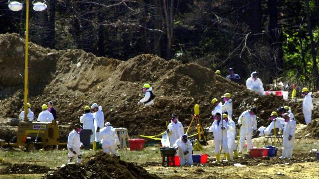 FBI investigators sorting through debris at the crash site of United Airlines flight 93 in Shanksville, Pennsylvania.