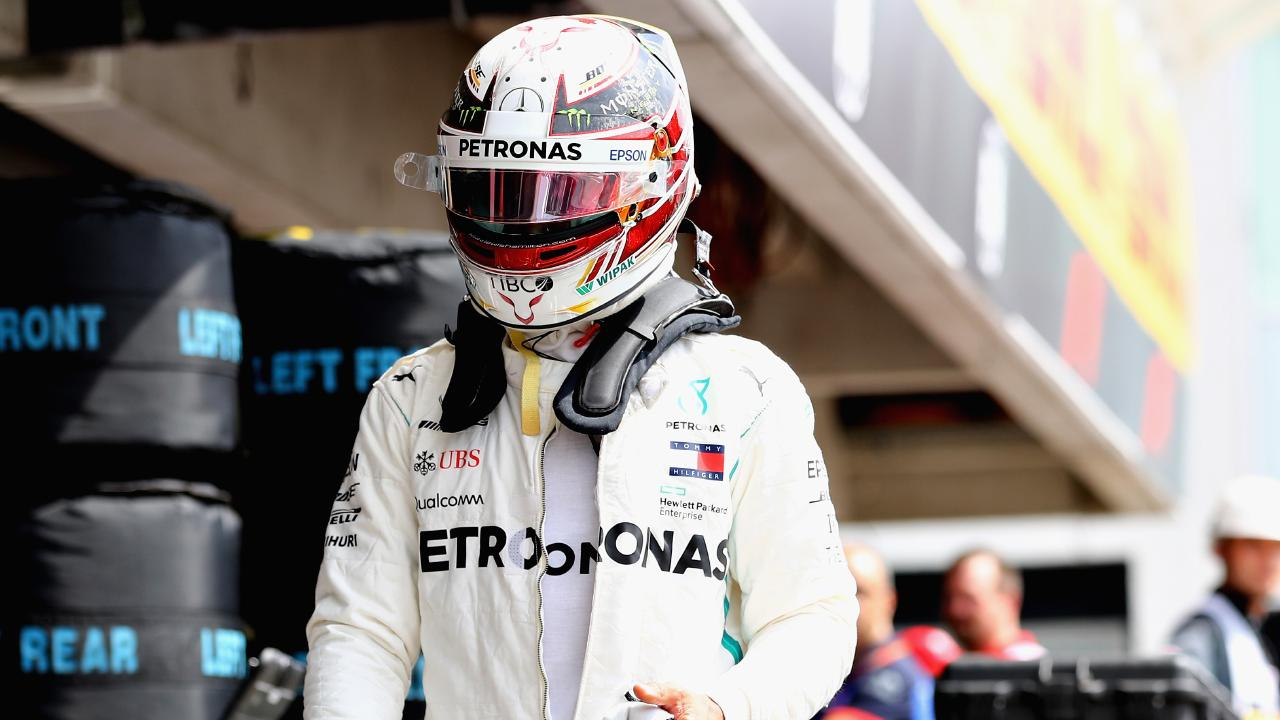 Lewis Hamilton returns to the pits after his car broke down in qualifying for the German Grand Prix on Saturday.