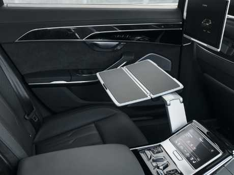 Optional fold-out tables and screens in the rear of the A8 ensure a suite ride.