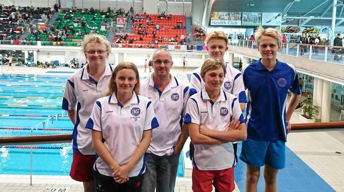 SUCCESSFUL TRIP: Lismore Workers Swim Club competitors at the NSW Country short-course championships in Sydney, from left, Aidan Yourell, Yazmin Harvey, coach Peter Harvey, Michael Bullpitt, Toby Campbell and Jacob Yourell.