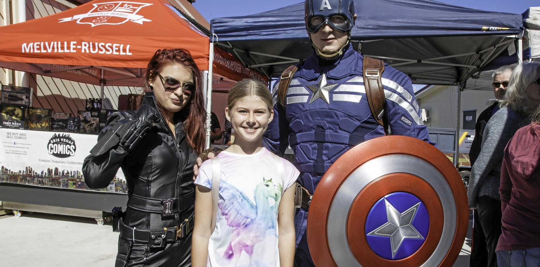 Chloe Hodges, 11, of Maryborough meets Black Widow and Captain America at FraserPop.