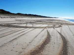 Beach 'idiot' caught doing 'kilometres of donuts'