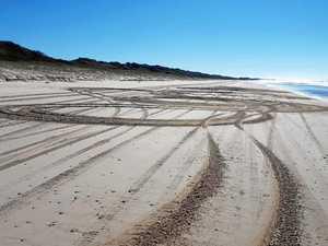 Beach 'idiot' caught doing 'kilometres of donuts'