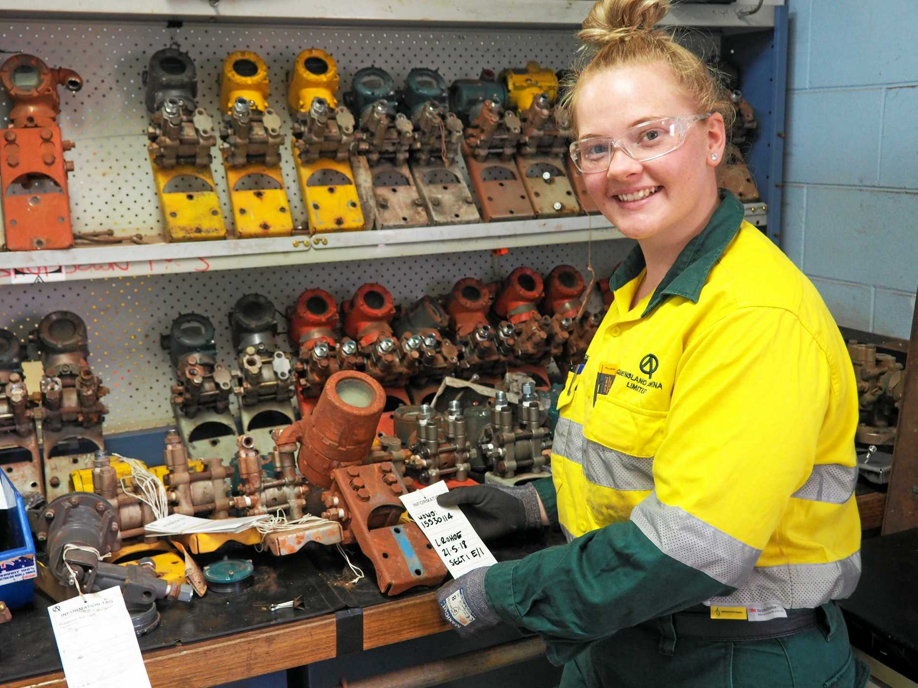 APPLICATIONS OPEN: Shianne Sprecher, third year electrical/instrumentation apprentice at Queensland Alumina Limited, checking level and pressure transmitters.