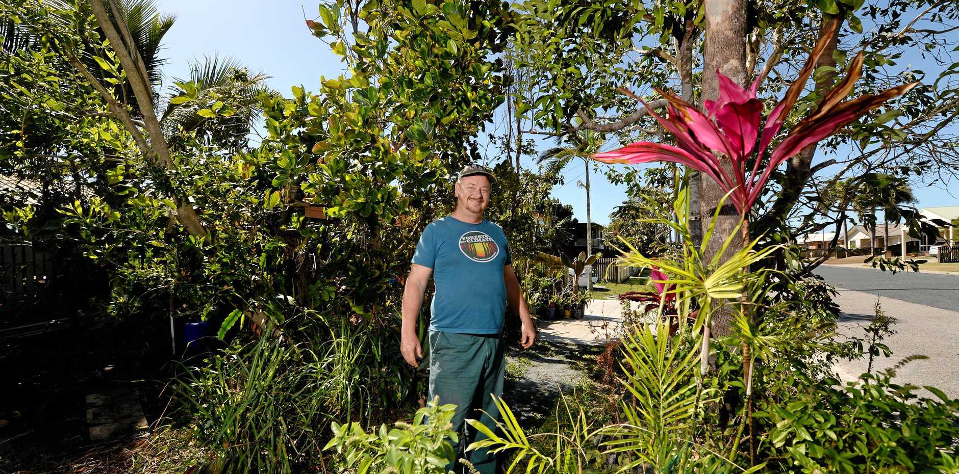 IT'S A MESS: South Mackay resident Larry Murchie thinks council is being too hard on him.