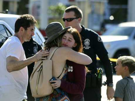 A Trader Joe's employee, right, hugs her loved after a gunman held dozens of people hostage inside a Trader Joe's supermarket. Picture: Christian Monterrosa via AP