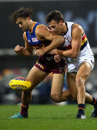Rhys Mathieson of the Lions collides with Tom Doedee of the Crows at the Gabba on Saturday. Picture: AAP Image/Jono Searle