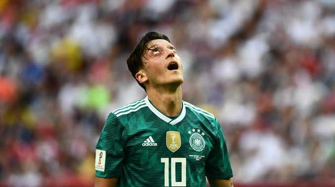 Mesut Ozil reacts after Germany's loss to the Korea Republic at the World Cup.