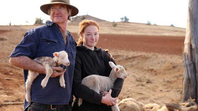 Farmer Les Jones with his daughter Lillie, 15, on their property at Goolhi with the remaining sheep in their flock. Picture: Sam Ruttyn