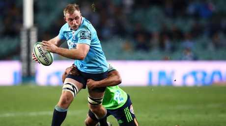 Will Miller of the Waratahs is tackled at Allianz Stadium.