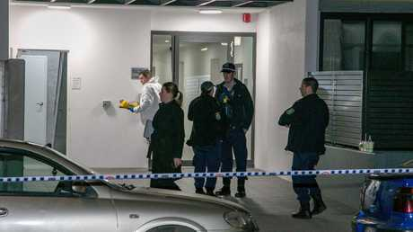 Forensic officers gather at front of the apartments. F Picture: Damian Hoffman