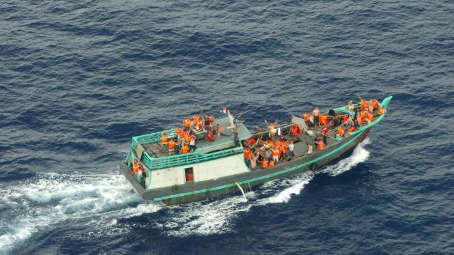 A boat carrying asylum seekers is intercepted in 2013 off Christmas Island. Picture: AFP