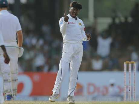 Sri Lanka's Akila Dananjaya took two wickets to place the hosts within five wickets of a 2-0 series sweep.