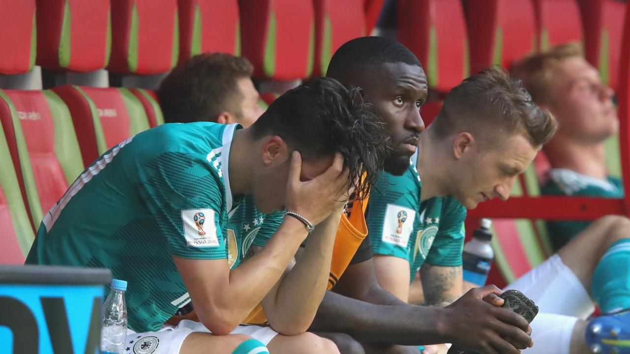 Mesut Oezil of Germany looks dejected following his sides defeat to the Korea Republic.