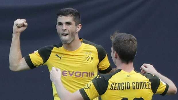 Borussia Dortmund's Christian Pulisic (L) celebrates with Sergio Gomez after scoring against Liverpool in the International Champions Cup.