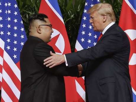 Kim Jong-un with US President Donald Trump last month at their Singapore summit. Picture: Evan Vucci.