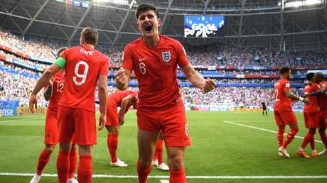 Harry Maguire of England celebrates with teammates after scoring his team's first goal against Sweden.