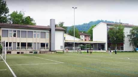 New intel reveals Kim Jong-un's days at the exclusive Swiss school (above) were airbrushed to gloss over his true nature.