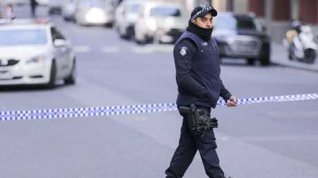 Police investigate a crime scene at the EQ Tower on A'Beckett Street in Melbourne, Saturday, July 21, 2018. Picture: AAP Image/Wayne Taylor.