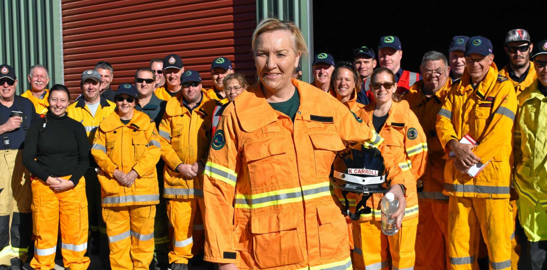 READY TO ROLL: Queensland Fire and Emergency Services Commissioner Katarina Carroll and members of the Rural Fire Service get ready for a training and testing exercise near Fordsdale on Saturday.