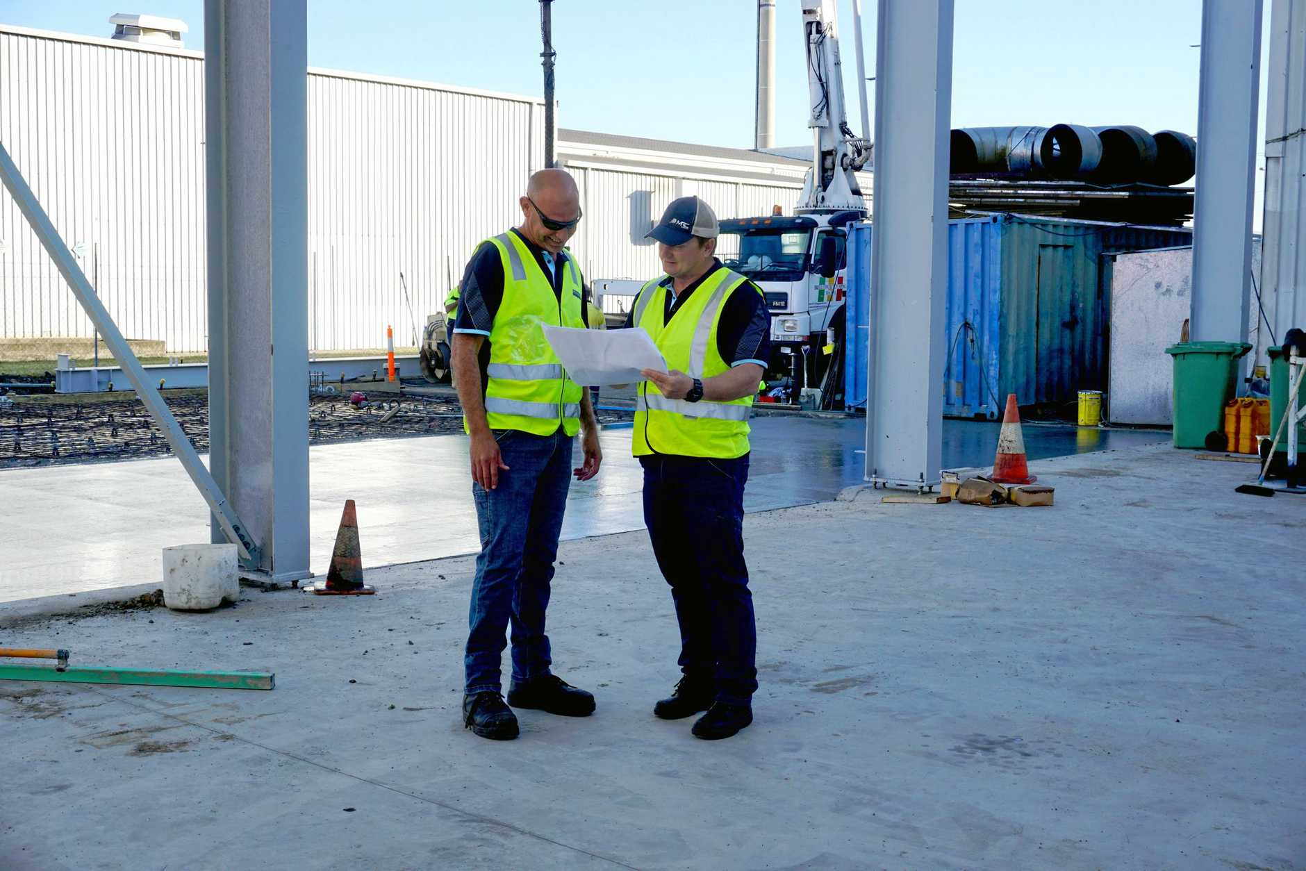 MRC Australia Group Operations Manager Anthony Borg, left, and Managing Director Scott Thorburn review the progress of the million-dollar expansion plans for the Boundary Road premises.
