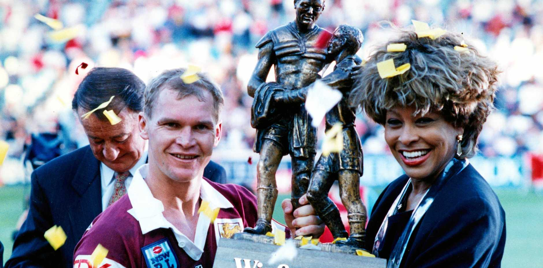 Brisbane captain Alfie Langer and American entertainer Tina Turner hold the Winfield Cup after the Broncos' grand final win in 1993 in Sydney
