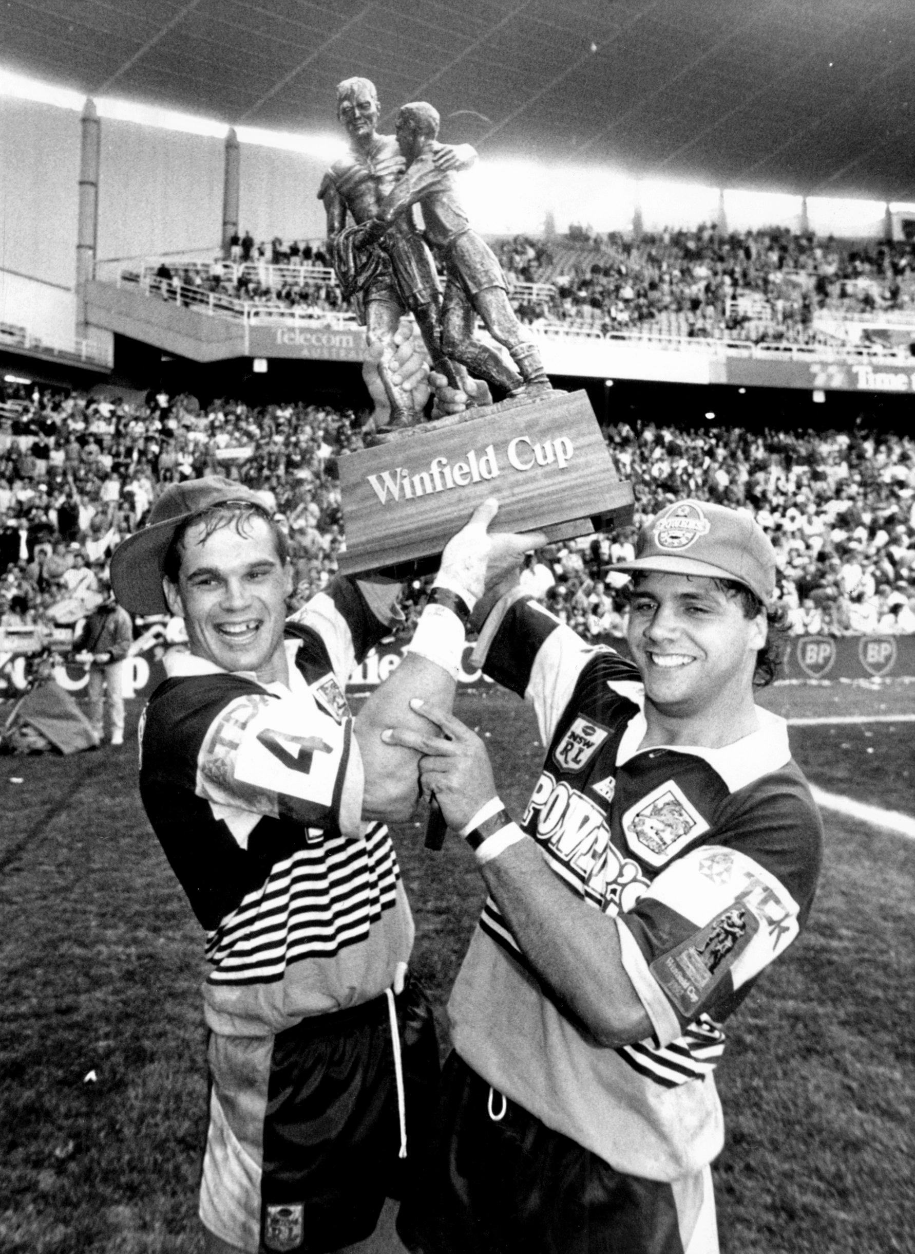 Chris Johns and Steve Renouf hold up the Winfield Cup in 1992. Photo: Gregg Porteous