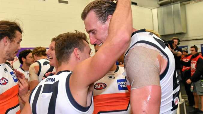 Zac Langdon and Gympie's Lachlan Keeffe (right) celebrate the GWS Giants' win over Port Adelaide on Sunday.