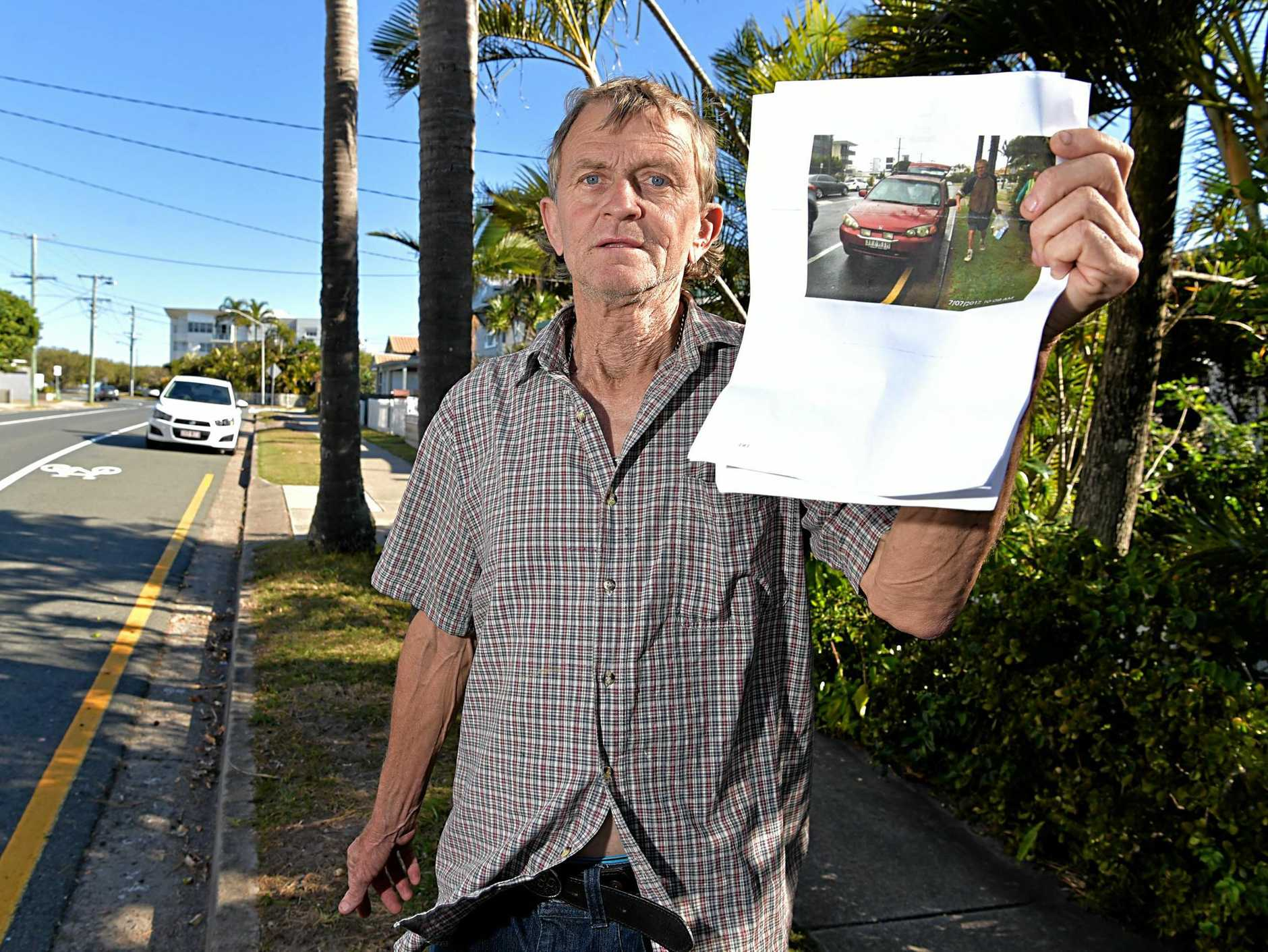 Peter Pearce is going to fight an infringement notice he was given for parking on a yellow line.