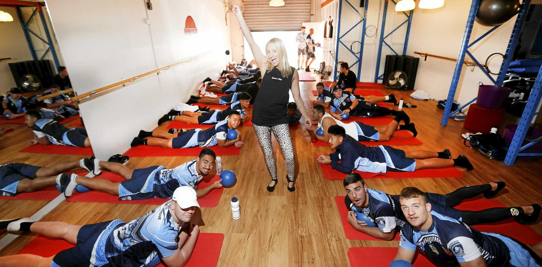 HOLD THAT POSE: The NSW Combined High Schools squad got in some recovery at Good Vibes Pilates & Yoga in South Tweed last week with instructor Kylie Beeby.