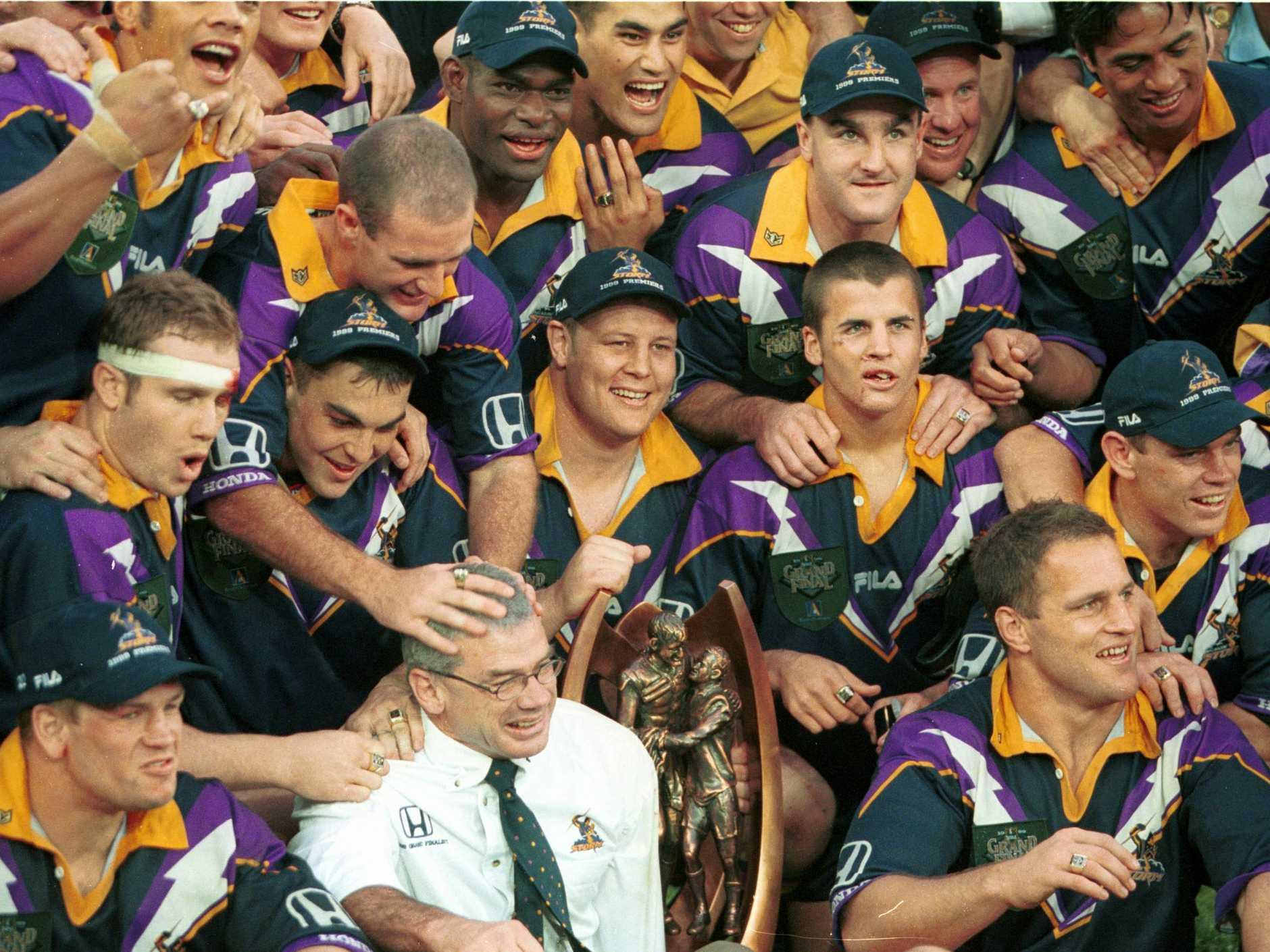 Storm players celebrate the 1999 NRL premiership.