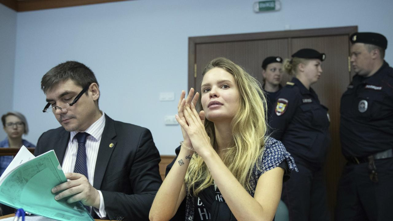 Veronika Nikulshina (R) a member of the feminist protest group Pussy Riot attends the hearings in a court in Moscow.