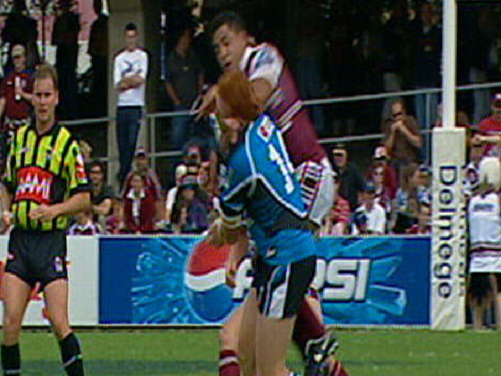 Manly's John Hopoate launches at Cronulla's Keith Galloway in 2005.