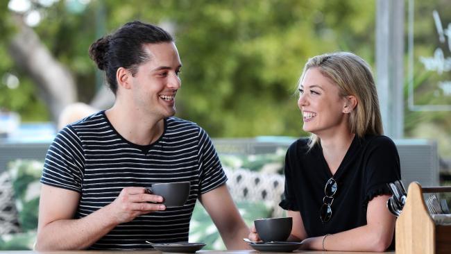 Nick Pelecanos, 25, and Sarah Kavanagh, 28, enjoying a morning coffee. Picture: Tara Croser.