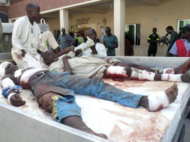 Injured victims of a suicide bomb attack receive treatment as they arrive at a hospital in Maiduguri, Nigeria, Monday, July 23, 2018. Picture: AP Photo/Jossy Ola