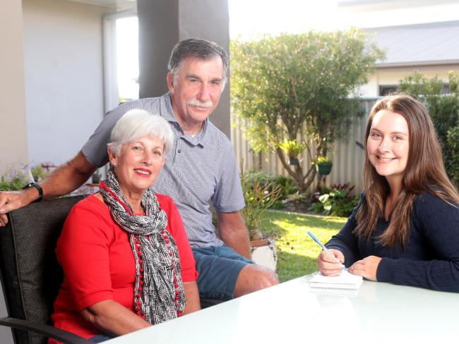 LOCKED IN: Bribie Island residents Vicky and Greg Beh with reporter Vanessa Marsh. Picture: AAP Image/Steve Pohlner