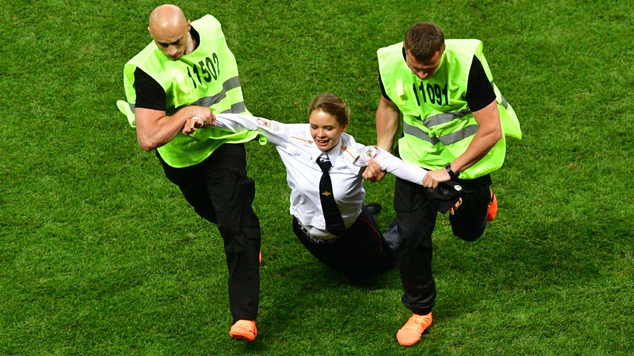 Security remove a pitch invader during the Russia 2018 World Cup final.