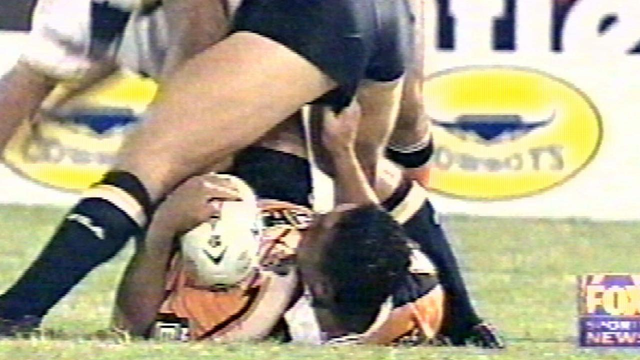 John Hopoate pokes the bottom of a Cowboys opponent in 2001.