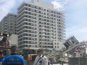 Apartment building collapses ahead of demolition