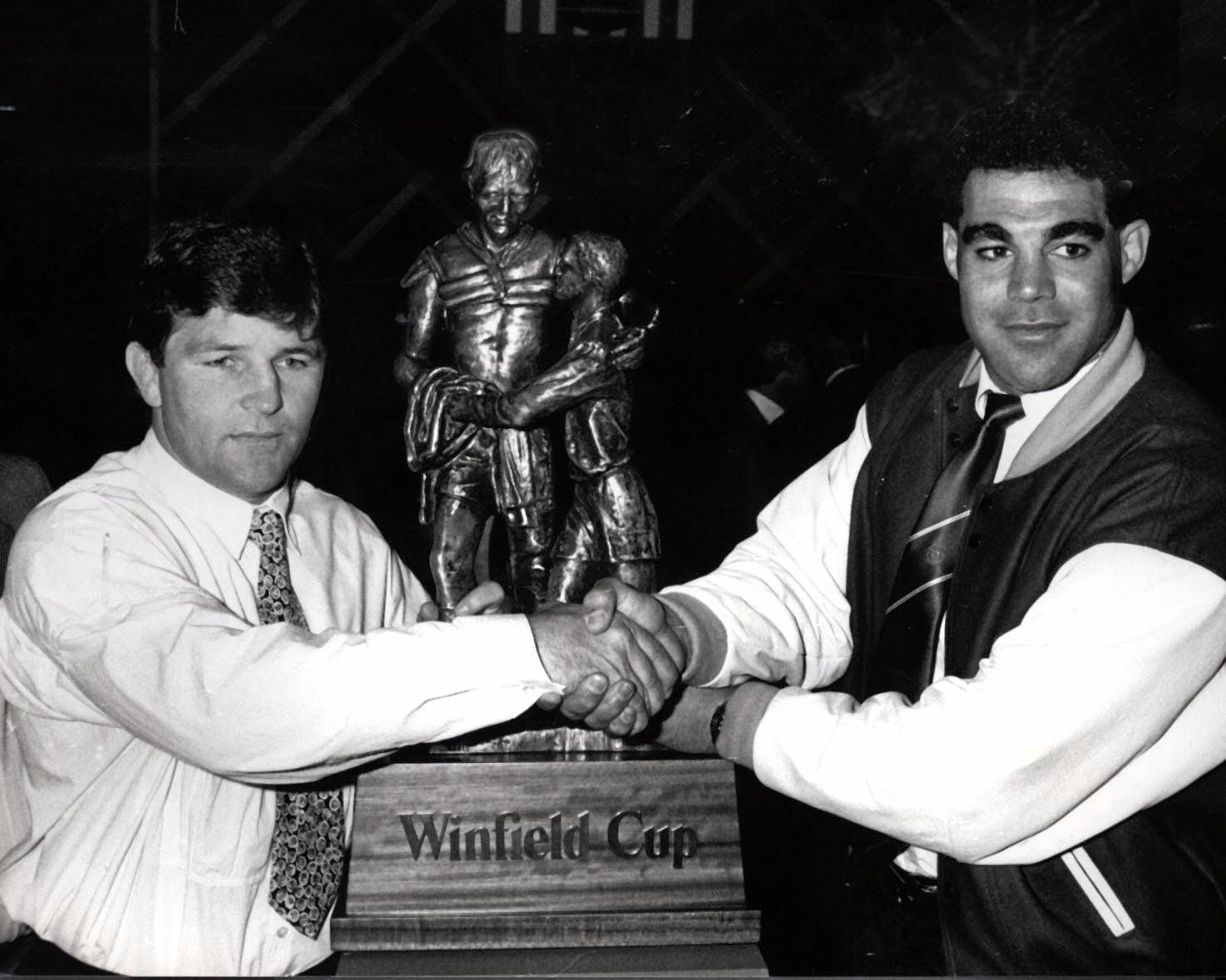 Captains Royce Simmons (L) from Penrith and  Mal Meninga from Canberra with the Winfield Cup trophy they would play for in the 1990 grand final.