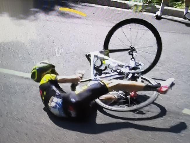 Adam Yates crashing in the closing kilometres while leading the race.