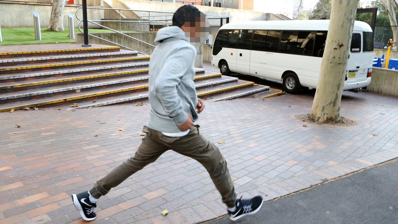 The man runs from Sydney Central Court on Wednesday. Picture: Hollie Adams
